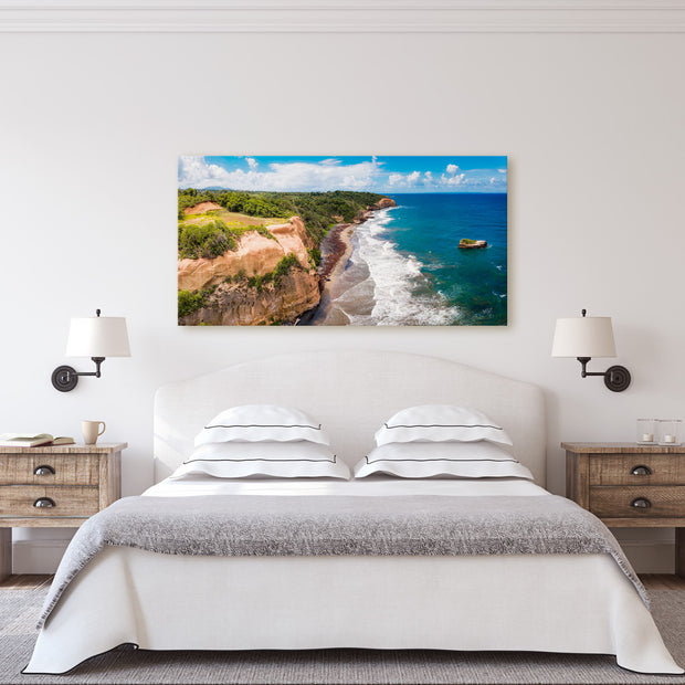 "A canvas print of ""Morning Blues I"" hanging over a living room fireplace."
