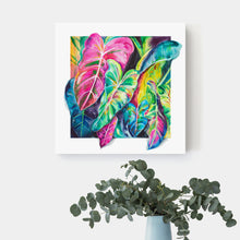 Load image into Gallery viewer, Colorful elephant ear canvas art hangs on a white wall