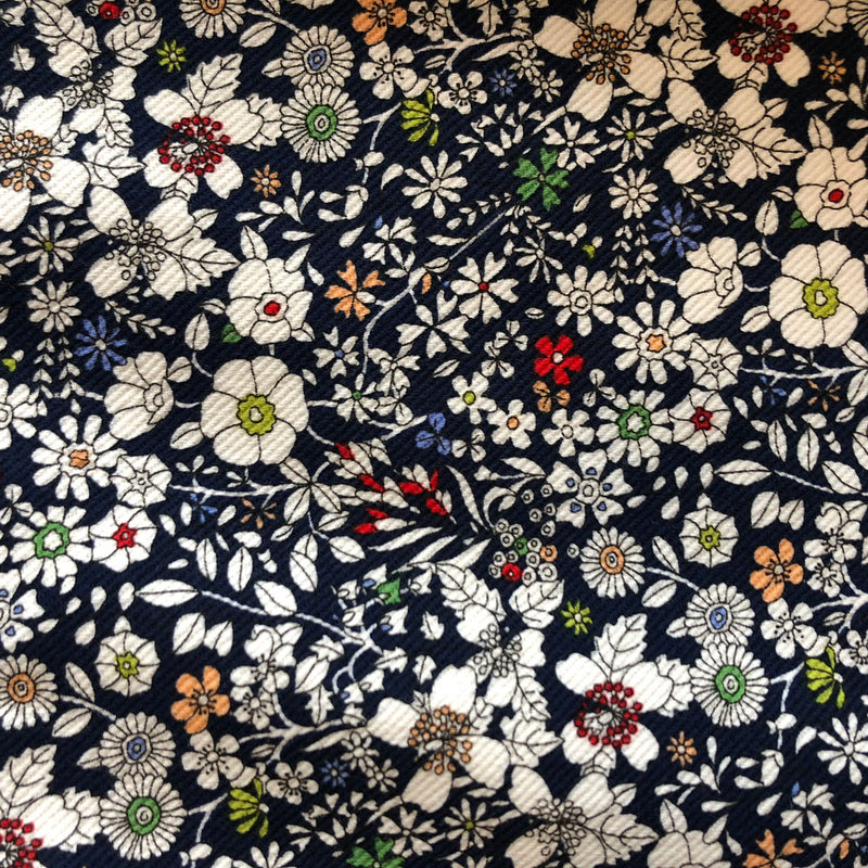 Close-up of navy liberty floral print denim