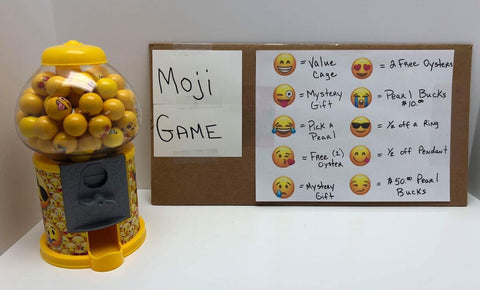 Moji Game How to Play: For every $65.00 dollars you spend on the website you get a Moji gumball.  Pre-order & you get two gumballs.  Whatever moji face is on the gumball you win that prize.