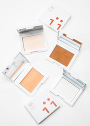 four open perfecting powder compact in four shades with mirrors and two closed
