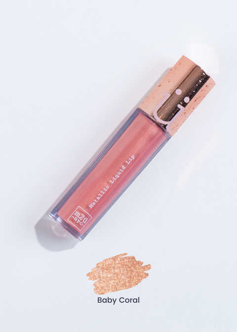 "metallic liquid lipstick in shade ""Baby Coral"" (orange coral)"
