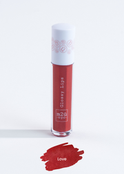"lip gloss in shade ""Love"" (red)"