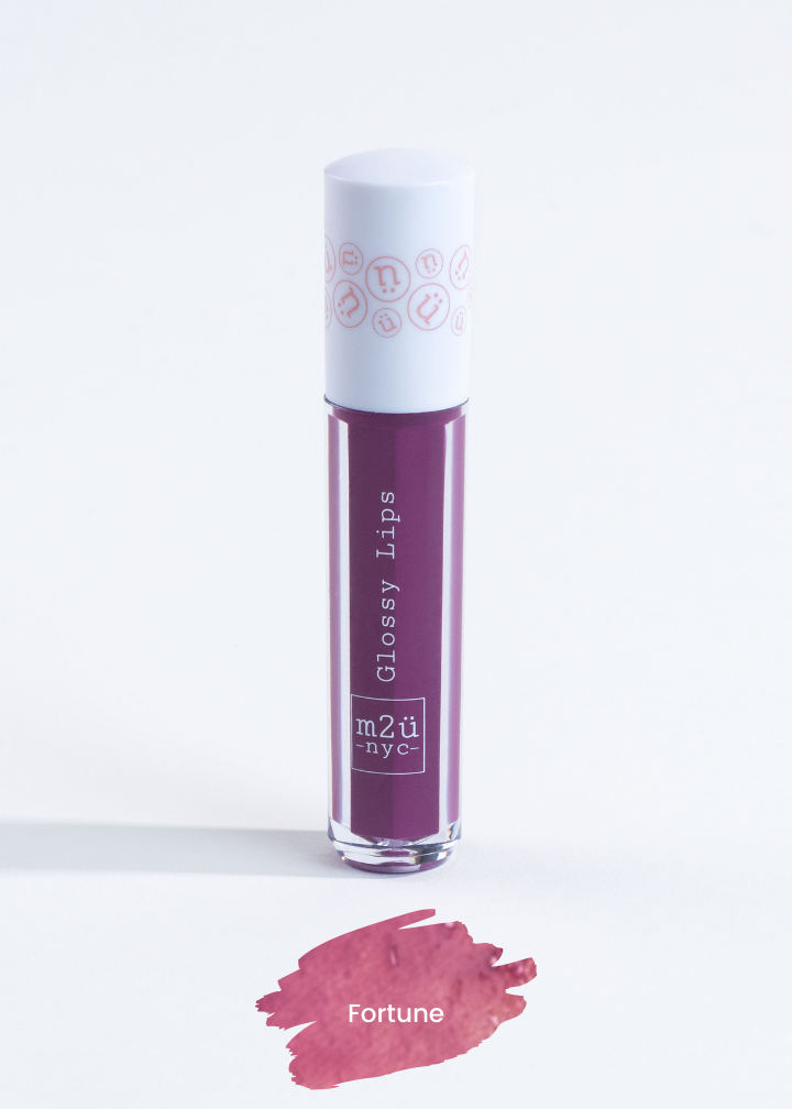"lip gloss in shade ""Fortune"" (purple)"