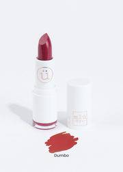 a moisturizing lipstick in shade dumbo, pink red