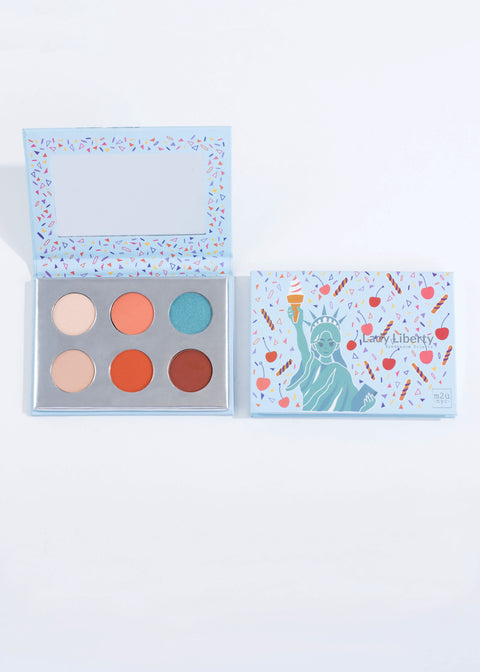 two of the same six pastel shade eyeshadow palette-lady liberty, one open one closed