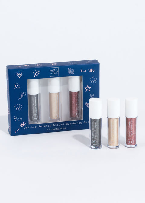 a blue box of the glitter eyeshadow set with three individual glitter eyeshadow bottles standing next to it