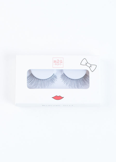 a pair of natural volume style false eyelashes for a subtle, sweet, feminine look