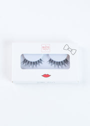 a pair of full-volume stacked style false eyelashes that gives a retro look