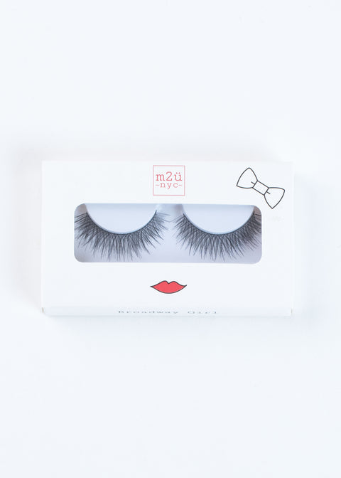 a pair of dramatic volume style false eyelashes in a white box with red lips