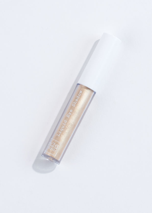 a bottle of liquid eyeshadow in shade prince- gold