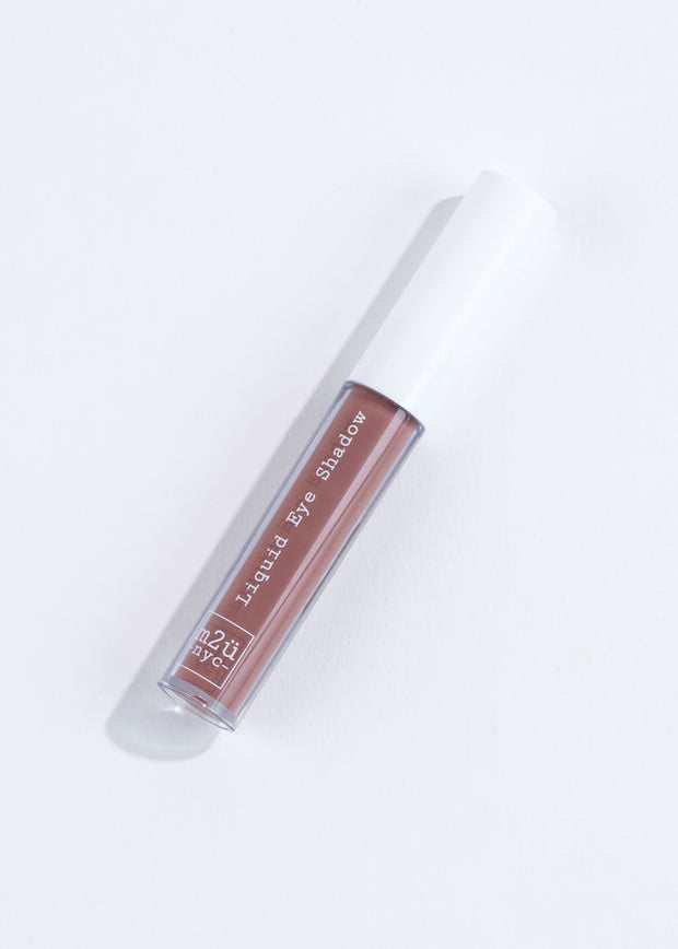 a bottle of liquid eyeshadow in dusty rose- dark pink