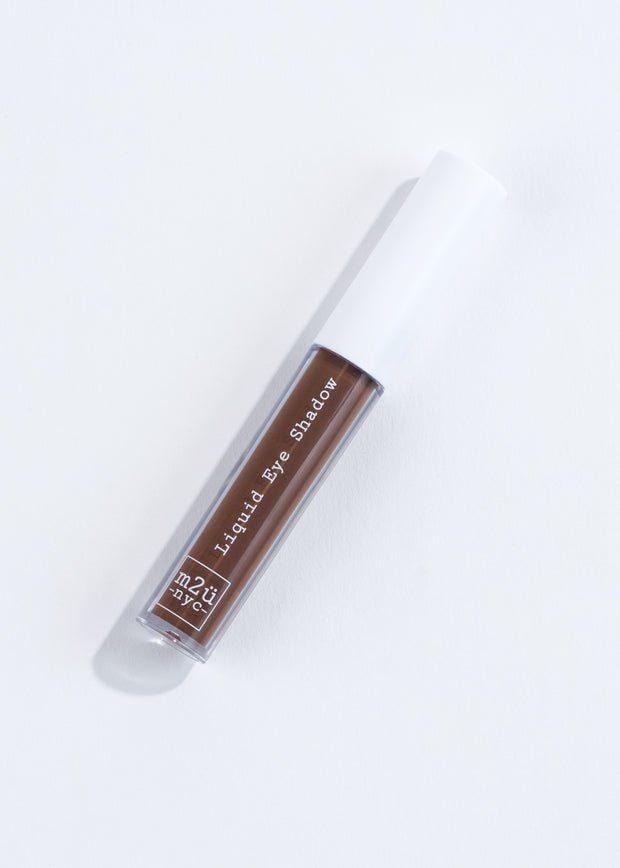 a bottle of liquid eyeshadow in chocolate- dark brown