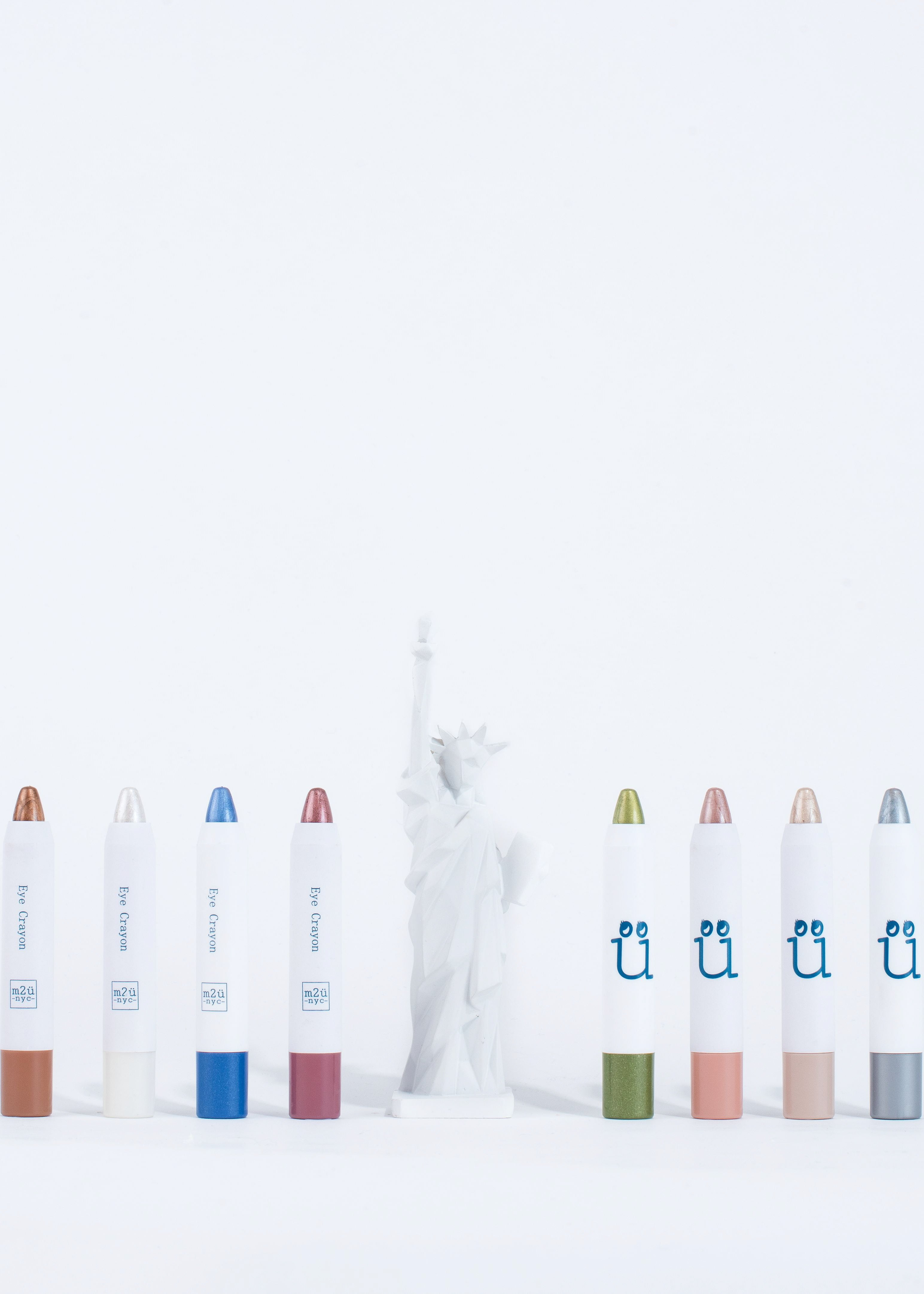full collection of eye crayons aligning with statue of liberty