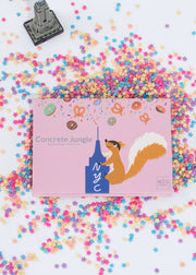 empire state building inspired eyeshadow palette sitting among colorful sprinkles and a mini empire state building