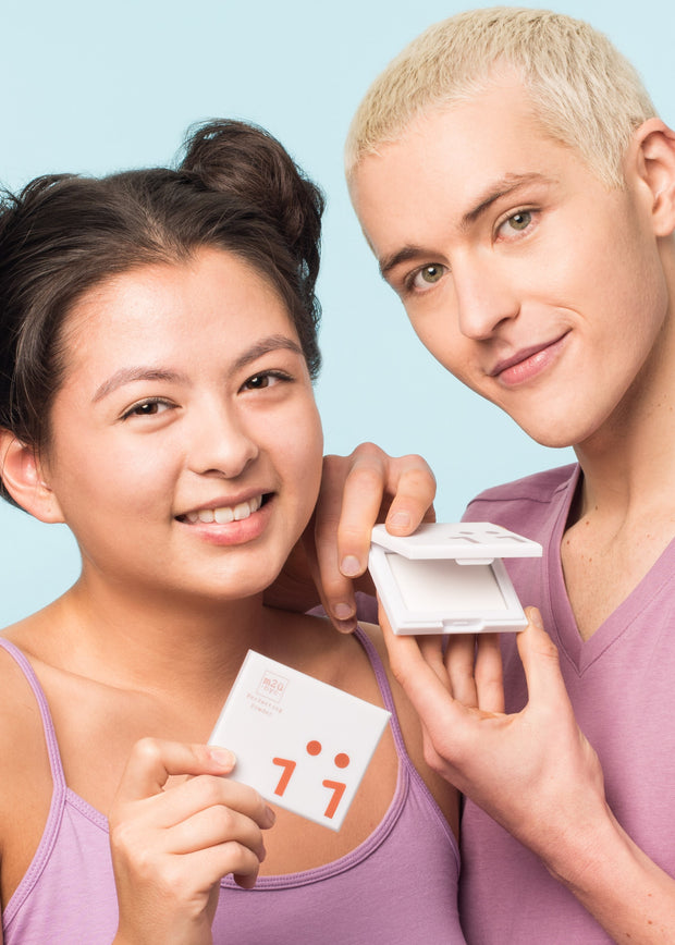 girl and man both smiling each holding one compact perfecting powder