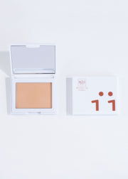 two perfecting powder compacts in shade medium, one open and one closed