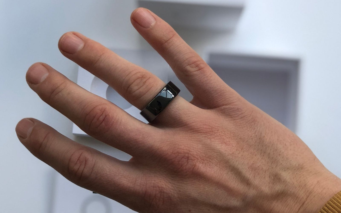Oura ring on mans hand