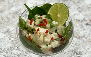 Fresh fish salad in a glass