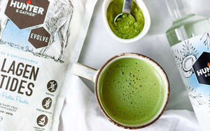 Green tea matcha hot drink with white crockery and protein collagen