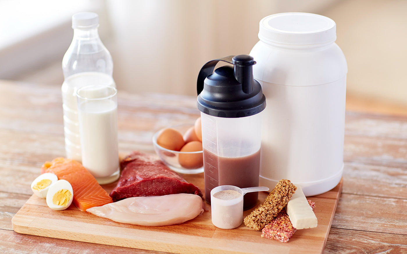Cutting diet: Protein shake next to lean meats, milk and eggs
