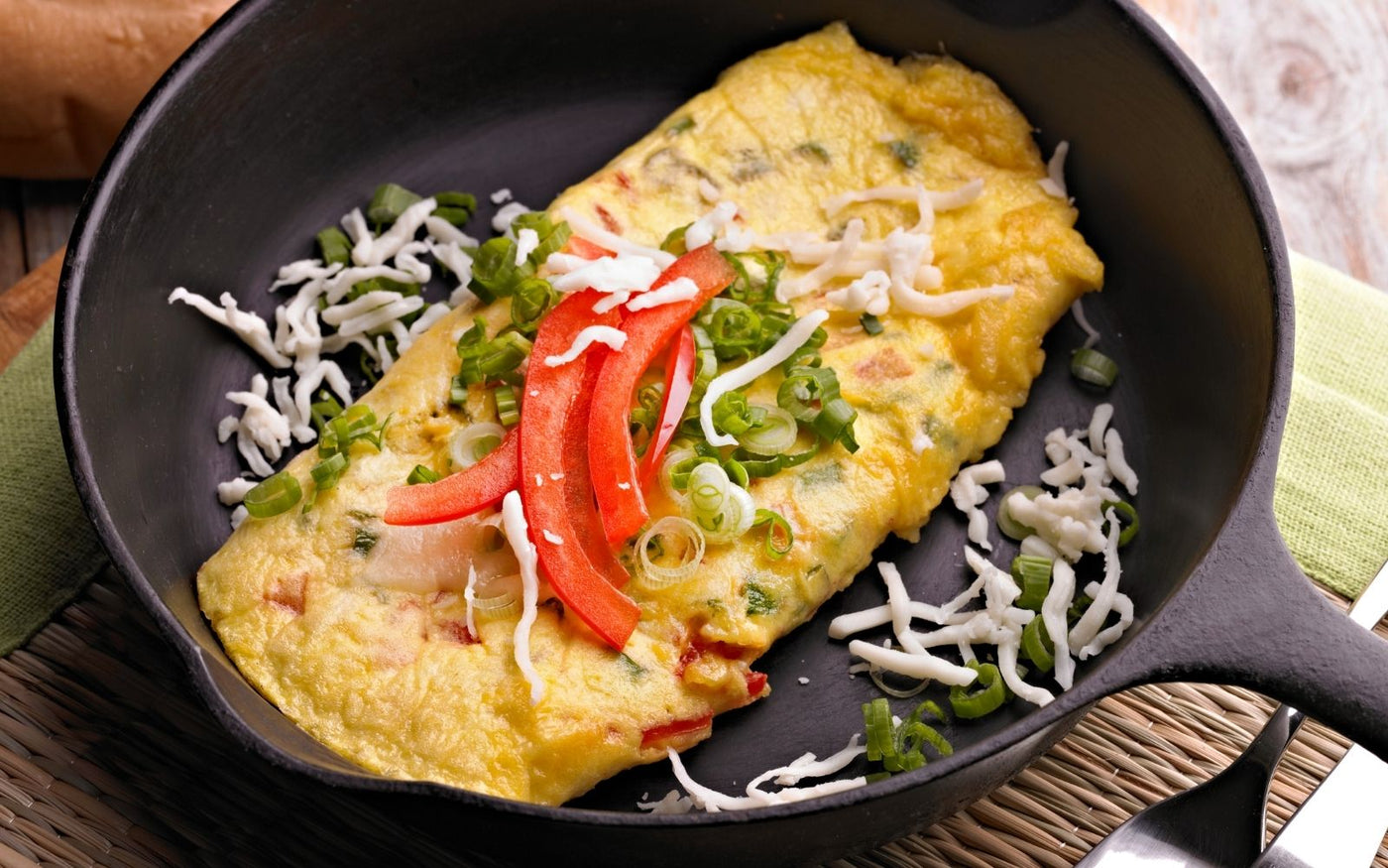 vegetarian keto diet: Stuffed egg omelette with vegetables on a plate
