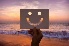 smiling pace in paper at beach