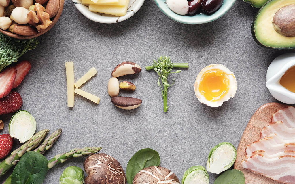 Keto spelled out using food surrounded by various healthy ingredients