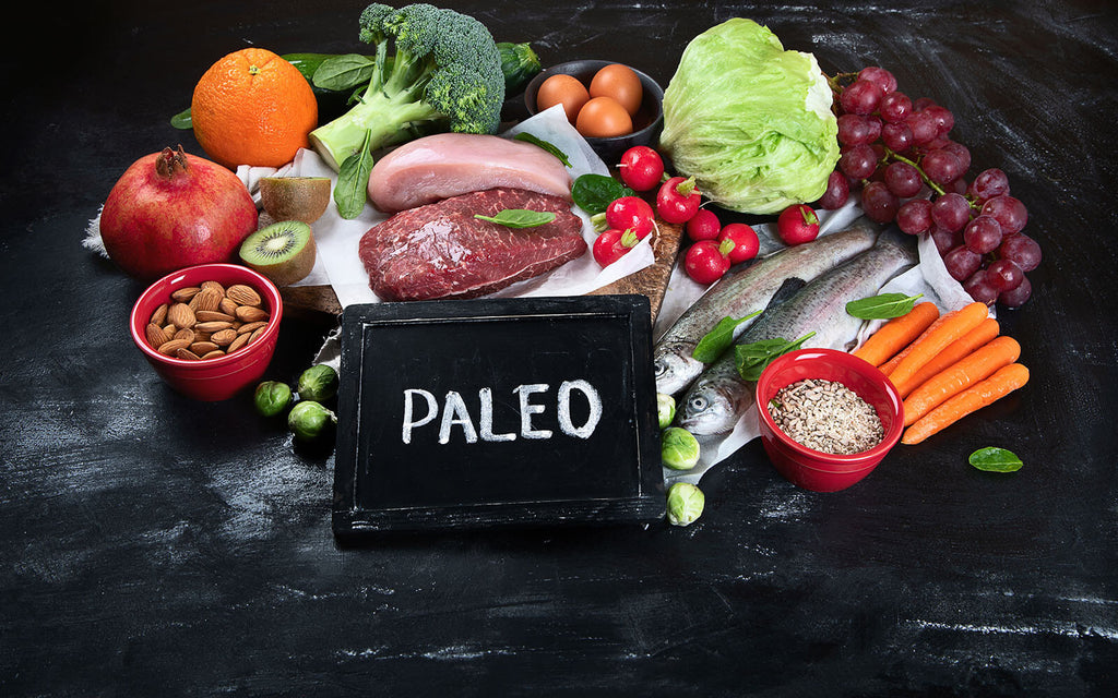 paleo vs keto: Various paleo diet products on a black surface