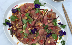 plate of beef salad with chilli and lime coconut