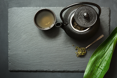 green tea in black teapot