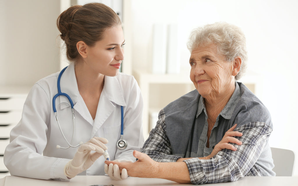 Doctor measuring blood sugar level of a patient