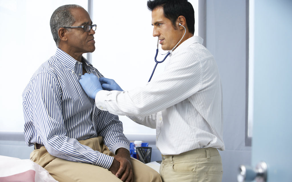 beef nutrition: doctor checking up an old man