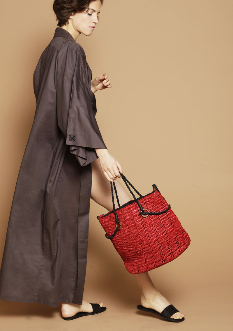 luxury resortwear outfit with robe and bag