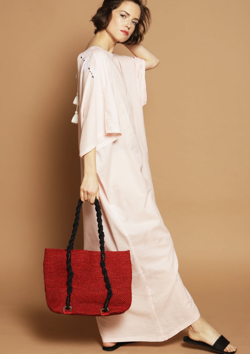 red raffia designer bag