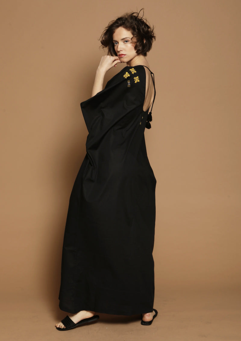 black beach dress with handmade embroidery for luxury travel
