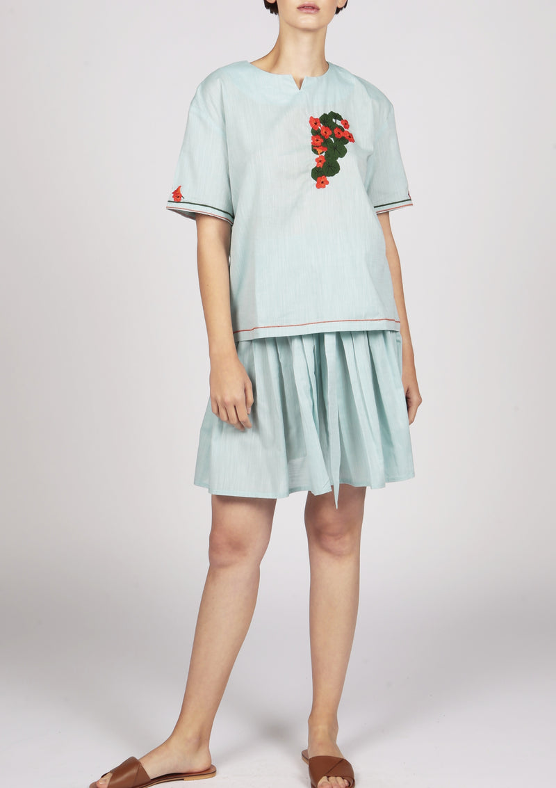 floral embroidery on a green shirt short sleeves