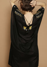 open back black dress with handmade embroideries