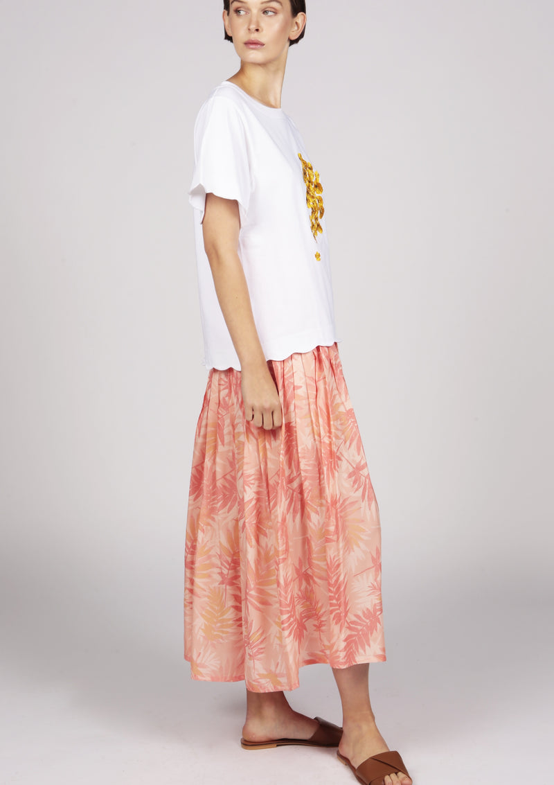 holiday summer outfit pleated printed skirt and white embroidered tshirt