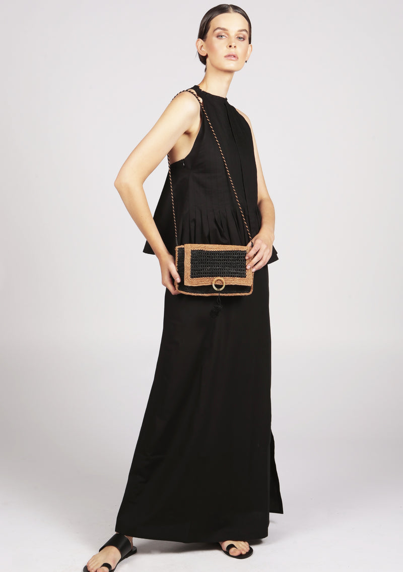 black maxi dress with designer raffia clutch
