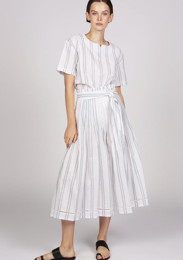 white pleated mid length skirt with bow tie