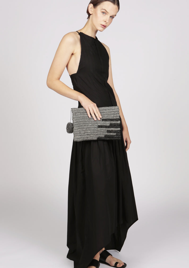 evening outfit edit clutch and black pleated evening dress