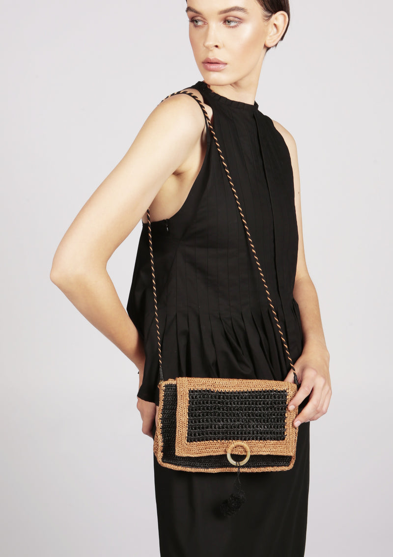 black raffia clutch for seaside dinner