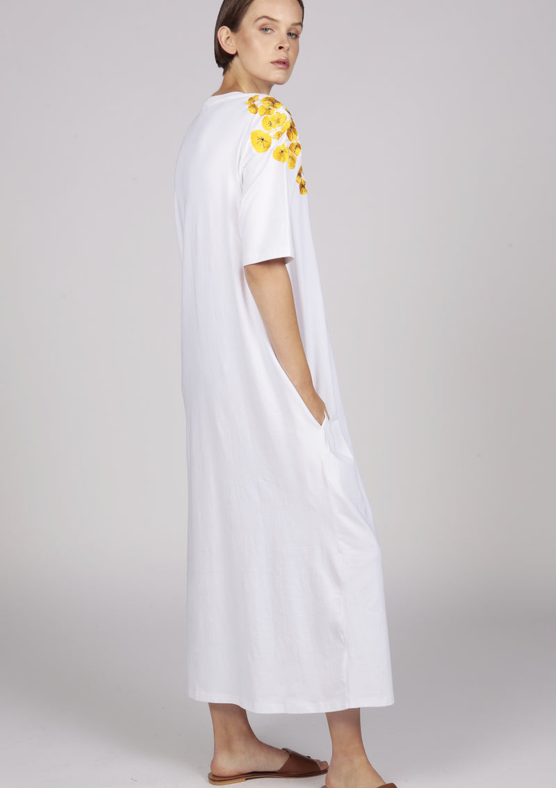 golden flower embroideries on a white maxi t-shirt dress