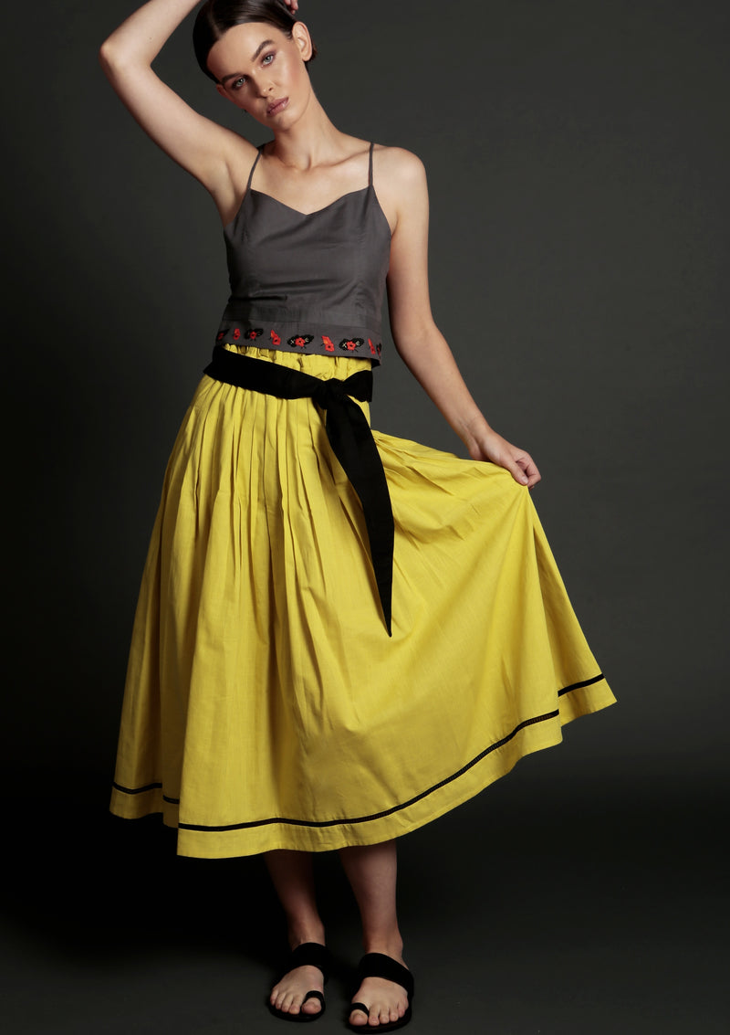 Maraina-London cropped top with floral embroidery with a pleated yellow midi skirt