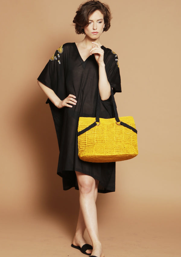 handmade raffia shoulder bag in yellow
