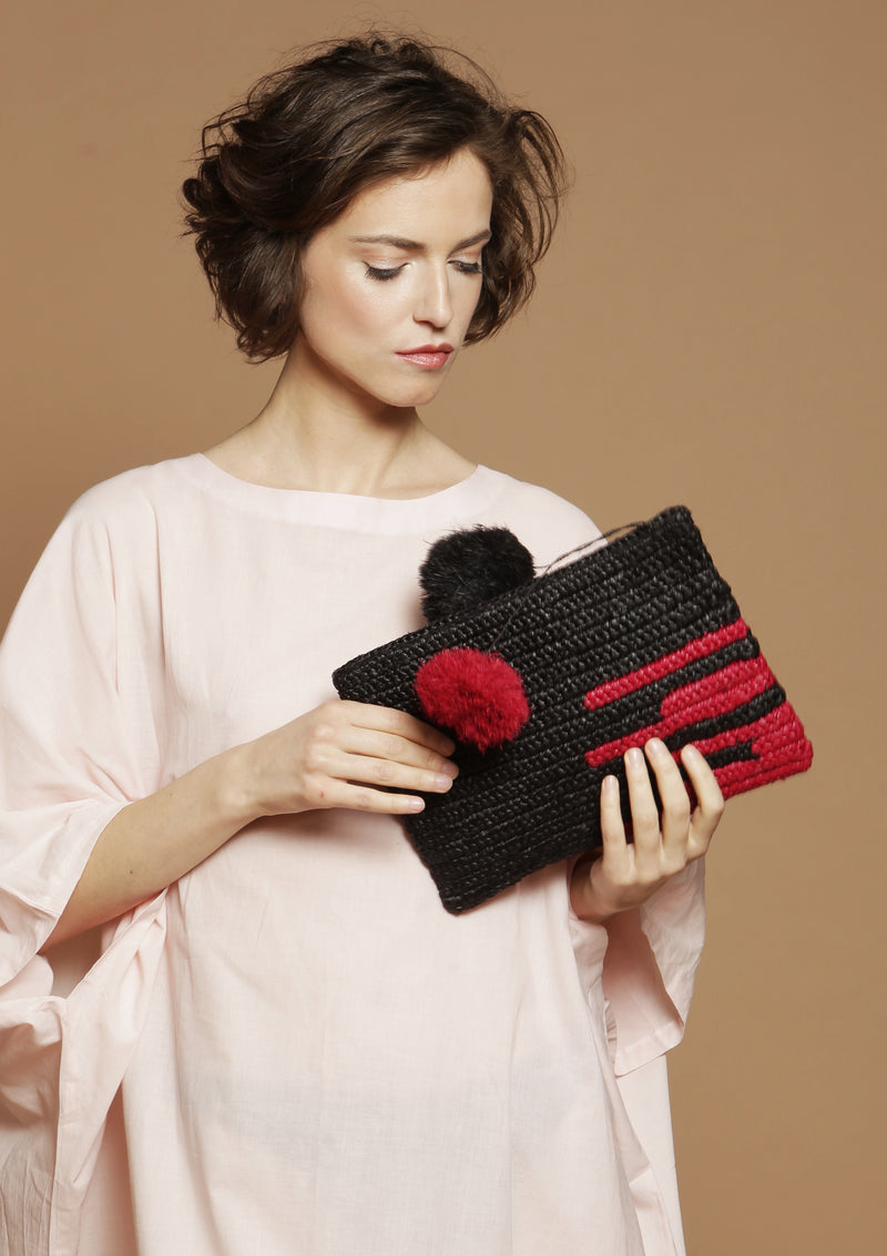 women raffia clutch bag