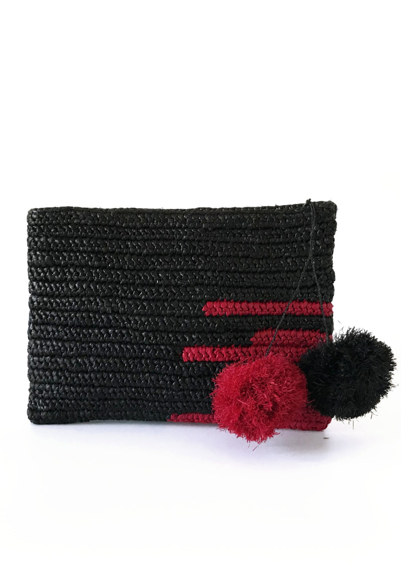 OLIVIA raffia pompom Clutch in black and fushia