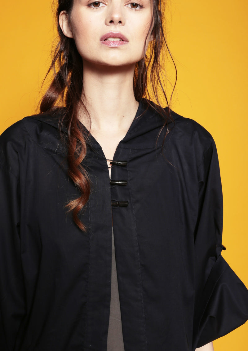 hooded gown with horn button sustainable fashion