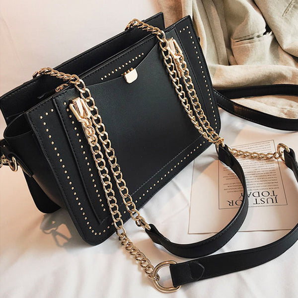 Cailyn Rivet Cross Body Bag